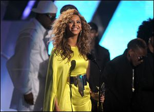 Beyonce accepts the award for best female R&B artist at the BET Awards.