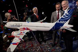 Alabama Gov. Robert Bentley, right, and Airbus President & CEO Fabrice Bregier celebrate the announcement that Airbus will establish its first assembly plant in the United States in Mobile, Ala.