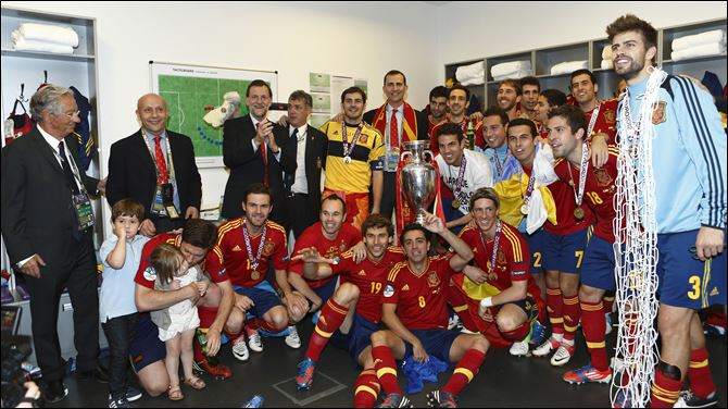 Ukraine Soccer Euro 2012 Final Spain Italy Spain's Crown Prince Felipe, top center, and Spain's Prime Minister Mariano Rajoy, top 3rd from left, join Spain's victorious soccer team in Kiev, Ukraine. Spain beat Italy 4-0 in the Euro 2012 soccer final.