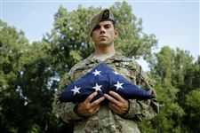 Ranger-Kyle-Bradley-holds-one-of-the-flags-he-carried-during-deployments