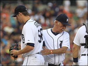 Detroit Tigers starting pitcher Doug Fister is replaced by manager Jim Leyland during the fifth inning of a baseball game against the Minnesota Twins.