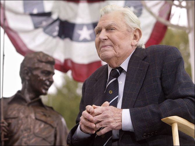 AP ANDY GRIFFITH Andy Griffith sits in front of a bronze statue of Andy and Opie from the 'Andy Griffith Show,' in Oct., 2003. A North Carolina TV station is reporting that the actor has died.