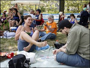 Katrina Bacome, left, and Matthew Wieczorek, both of Toledo, play a game of