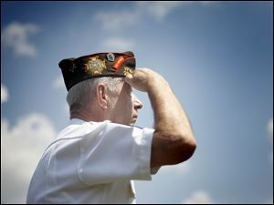 John Hall of Northwood VFW Post 2984 salutes the American flag on July 4th.