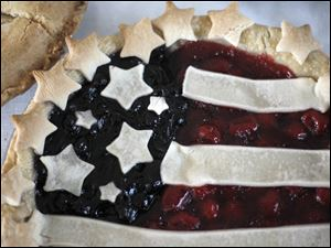 A homemade pie decorated like the American flag is one of the many desserts at a Fourth of July party at the Luther Ridge Senior Apartments.