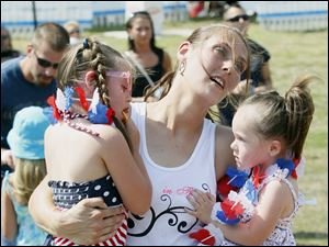 Carrie Burk of Toledo dances with her daughters Tabitha, 4, and Taylor, 1.