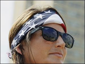 Lauren Vece of Los Angeles, Calif., listens to the music during the July 4th festival in Toledo.