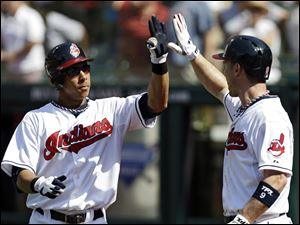 Cleveland Indians' Michael Brantley, left, is greeted by Jack Hannahan after Brantley's three-run home run off Los Angeles Angels starting pitcher Ervin Santana in the first inning Wednesday.