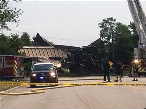 Police investigate the scen of a train derailment in Northbrook, Ill. on Wednesday. A Union Pacific spokesman says a freight train derailed and a bridge over a stretch of road has collapsed in the northern Chicago suburbs.