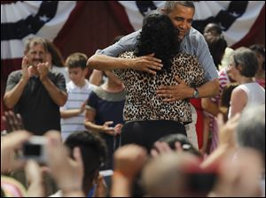 President Barack Obama hugs Ina Sidney prior to his speech at the Wolcott Museum in Maumee.