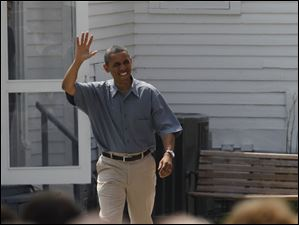 President Barack Obama waves as he's being introduced.
