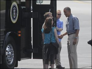 Jeff and Cheri Armes greet the President.