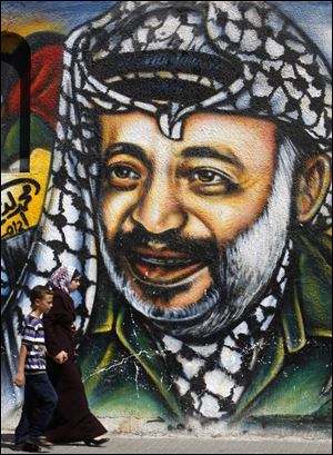 An image of Palestinian leader Yasser Arafat, who died Nov. 11, 2004, fills a wall in Gaza City.