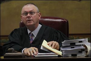 Fulton County Courthouse visiting judge Sumner Walters presides over the murder trial of Walter E. Zimbeck, II, 45, who is charged in the 1985 murder of Lori Ann Hill, 14.