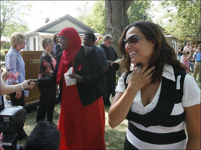 in the Independence Day naturalization ceremony at Sauder Village