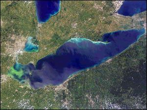 This satellite photo shows Lake Erie in 2011. The green coloration at left is an algae bloom that grew over a section of the lake.