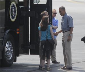 Jeff and Cheri Armes greet the President before boarding the bus with him at Toledo Express Airport.