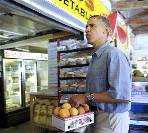 The President buys fruit at Bergman Orchards farm market in Port Clinton.