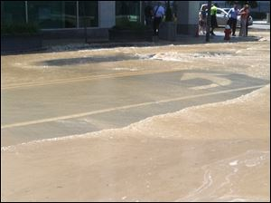 Downtown Toledo streets are flooded after a water main break.