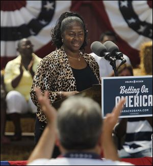 Ina Sidney, a Chrysler plant worker, introduces President Obama at the Wolcott House Museum in Maumee.