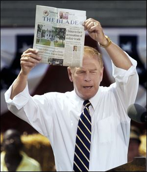 Former Ohio Gov. Ted Strickland shows a copy of Thursday's edition of The Blade, noting the President's plans to file an international trade case against China.