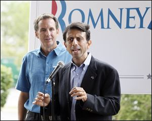 Gov. Bobby Jindal of Louisiana speaks to about 20 people in front of the Courtyard by Marriott in Maumee as former Gov. Tim Pawlenty of Minnesota listens.