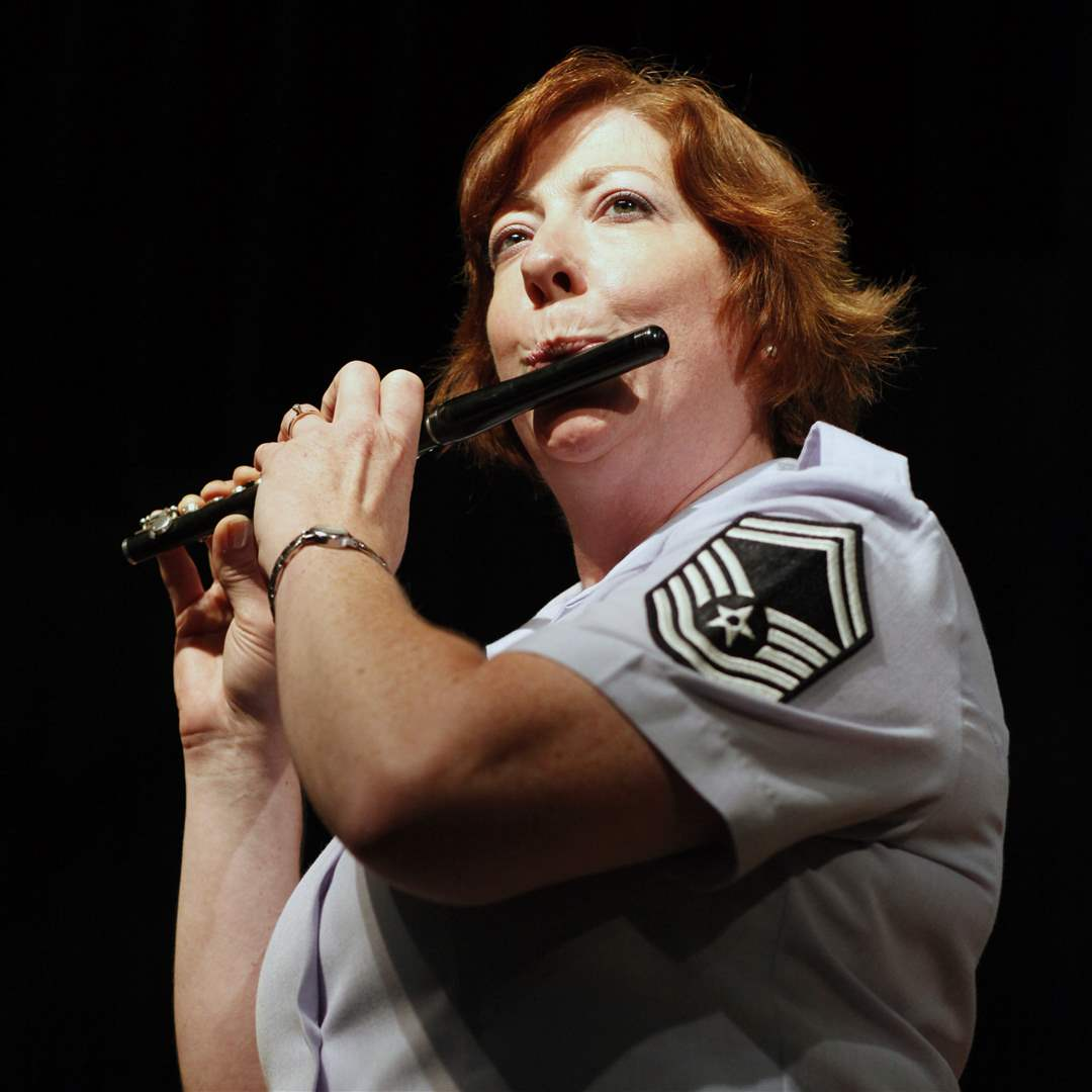 MSgt-Kathleen-Schulak-of-Toledo-plays-the-flute