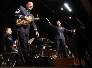 MSgt Stanley George of Bowling Green, Ohio, plays the Alto Sax as Captain Haley Armstrong conducts during the  555th Air National Guard Band's last concert Saturday, at Anthony Wayne High School in Whitehouse, Ohio. The band, also known as the Air National Guard Band of the Great Lakes, has been decommissioned.