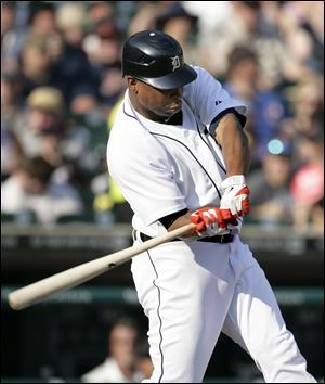 Detroit Tigers' Delmon Young swings on his seventh-inning two-run home run against the Kansas City Royals in a baseball game on Saturday.