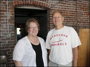 Mary Kay, of Holland, Director of Monclova Community Center, left, and Bill Strayer, who attended the Monclova School, in front of a brick arch over a doorway in the basement.