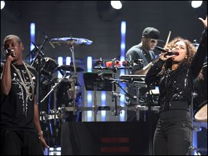 Rapper Jay-Z and singer Alicia Keys perform onstage at the iHeartRadio Music Festival held at the MGM Grand Garden Arena on Sept., 2011.
