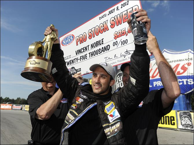 NHRA Auto Racing Vincent Nobile celebrates after winning Sunday's Pro Stock title race in Norwalk. The win followed his all-star victory on Saturday.