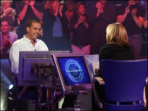 Meredith Vieira, right, host of 'Who Wants to be a Millionaire' and Chad Justen, a Toledo contractor who was on the show in 2008.