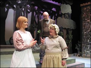 In the Archbold community Theatre production of 'Into the Woods,' the Narrator, played by Ken Bower, observes a scene with Carissa McCurdy, left, and Karen Bower.