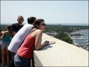 Colleen Carey of Fort Collins, Colo., enjoys the view from the top of the Perry's Victory and International Peace Memorial on South Bass Island.