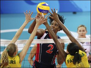 Danielle Scott-Arruda of the U.S. spikes against Brazil in the gold medal volleyball match at the 2008 Beijing Olympics. The 39-year-old from Baton Rouge is headed to her fifth Olympic Games.