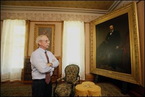 Thomas Culbertson, executive director of the Rutherford B. Hayes Presidential Center, admires a painting in the Hayes home.