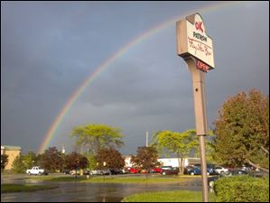 A rainbow bows over OK Patron in Perrysburg, Ohio.