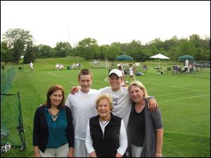 Carol Bently of Perryburg, front, with her daughter, left, Pam Bently Thorne of Manchester by the Sea, Mass., grandson Grant MacPherson with his mom Kate Bentley MacPherson of Perrysburg, and Kevin Brown from St. John's High School.
