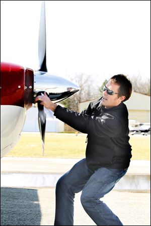 Flight student Don Coburn, from Sylvania, does a preflight check on a Cessna 182 before proceeding with Instrument flight rules (IFR) training with Suburban Aviation, Inc. Flight Instructor Nick Zink.