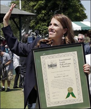 Jennifer Capriati waves during the Tennis Hall of Fame induction ceremonies. She won three major titles.
