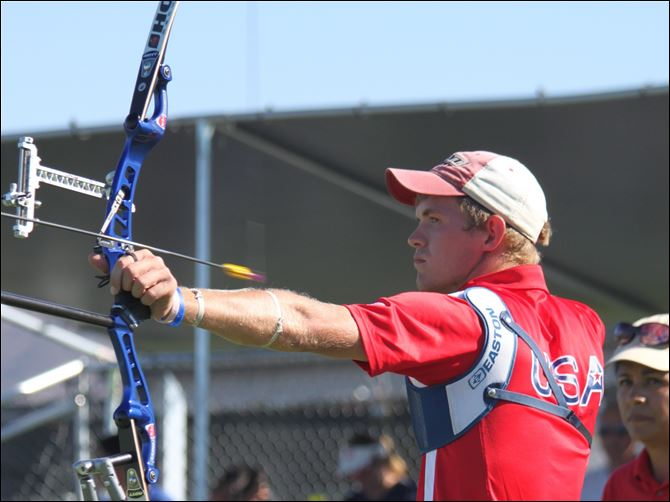 Archery_Wukie_Jacob_Action.jpg Still focused, Jacob Wukie of Oak Harbor watches the arrow as it leaves his bow headed for a target down range. Wukie has qualified for a third spot on the nation's Olympic archery team.