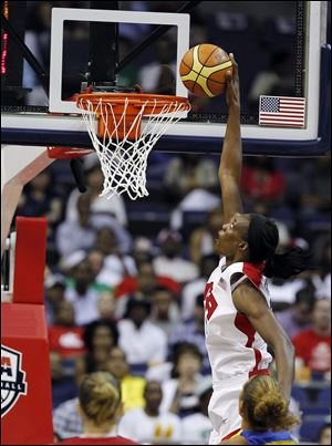 Team USA center Sylvia Fowles goes up for a dunk, which bounced out, during the second half of an Olympic women's exhibition basketball game with Brazil on Monday in Washington. The United States won 99-67.