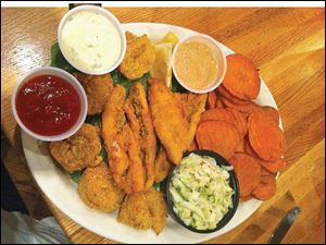 Fried perch and shrimp with cole slaw and sweet potato chips.
