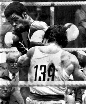 Louis Self of Toledo lands a punch against Angelos Theotokatos of Greece in a featherweight bout Self won in the 1972 Munich Games.