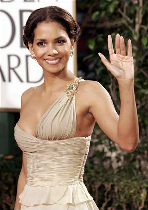 Halle Berry arrives for the Golden Globes.