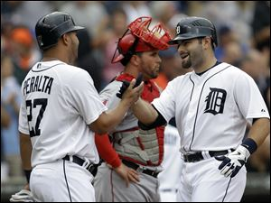 Detroit Tigers' Alex Avila, right, celebrates his two-run home run with Jhonny Peralta  in the second inning Thursday.