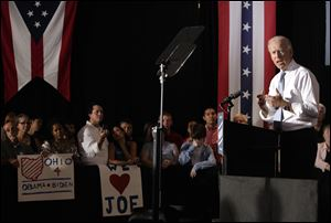 Vice President Joe Biden told a crowd at a plumbers' union hall in Columbus that President Obama's policies have boosted manufacturing in Ohio. Mr. Biden criticized GOP candidate Mitt Romney's opinion column entitled 'Let Detroit Go Bankrupt.'