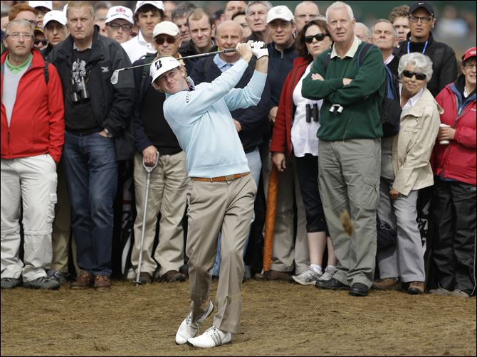 Brandt Snedeker of the United States Brandt Snedeker of the United States plays a shot from the rough on the second hole at Royal Lytham & St Annes golf club during the second round of the British Open Golf Championship, Lytham St Annes, England, Friday.