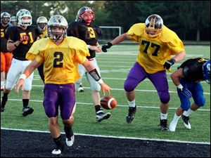 Gold Squad quarterback Jake Schneider (2) of Maumee High School scores a  touchdown against the Black Squad during the 22nd annual Regional All-Star Football Game Friday.